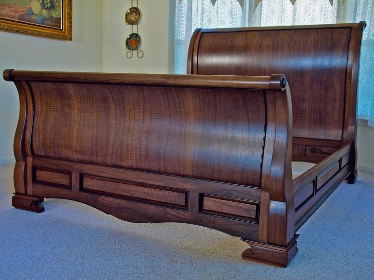 figured walnut sleigh bed
