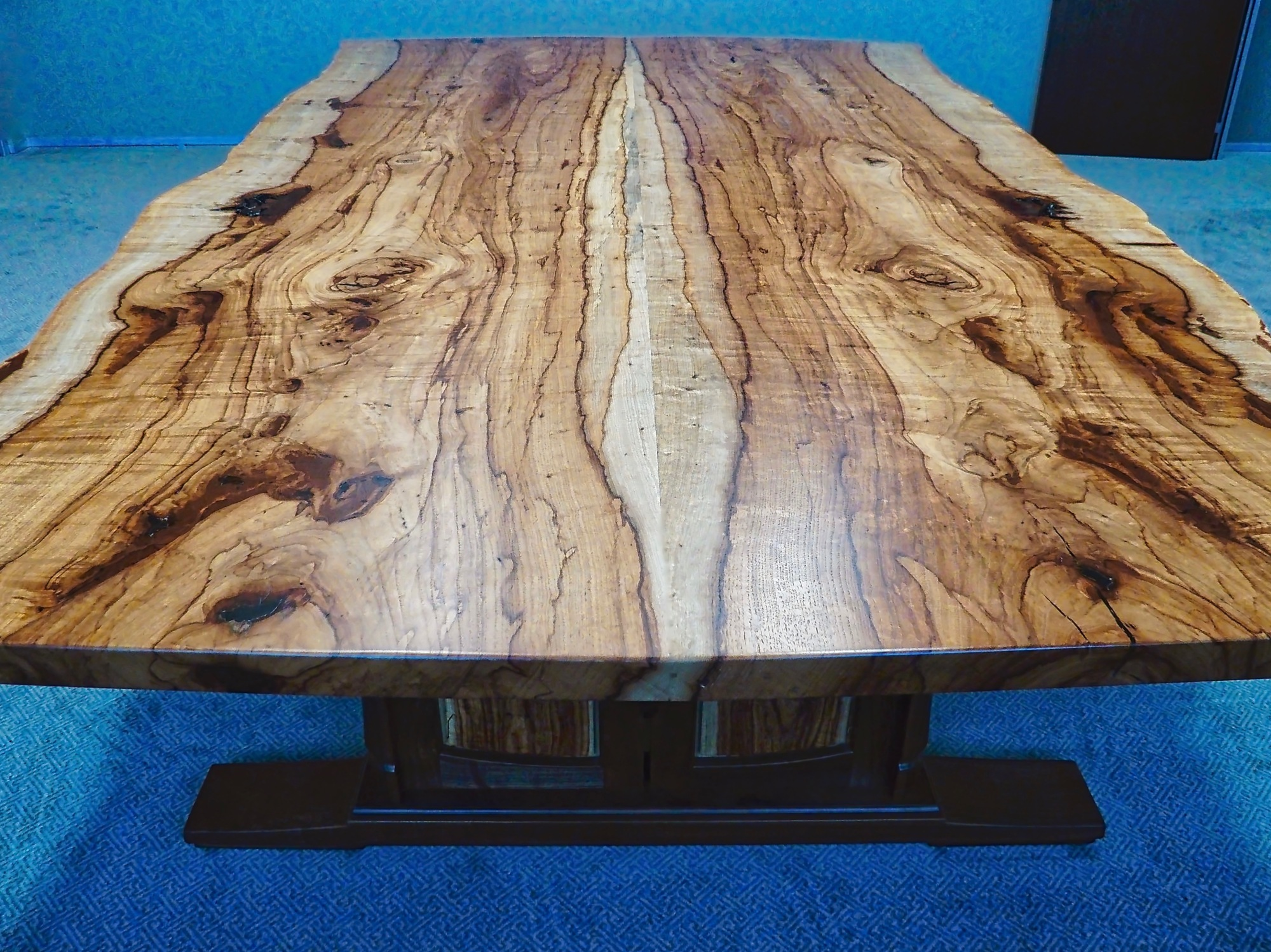live edge book matched Texas pecan slabs with exceptional figure and color.