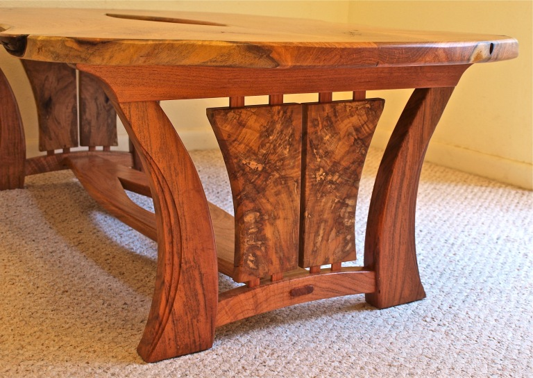 Live edge Texas mesquite coffee table with Texas pecan end panels.