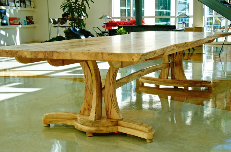 Live edge Texas pecan conference table with sculpted base.