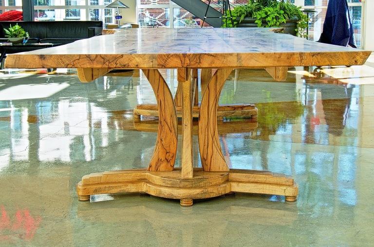 Live edge Texas pecan table with sculptural base.